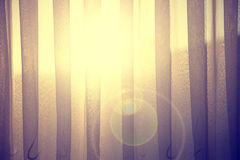 Conceptual sunbeams through curtain with flare Royalty Free Stock Photography