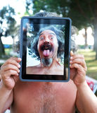 Conceptual Tablet portrait photography. Middle age man enjoys playing around with his tablet. A third of American adults now own tablet computers stock photography