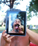 Conceptual Tablet portrait photography. Middle age man enjoys playing around with his tablet. A third of American adults now own tablet computers stock photo