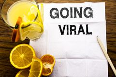 Conceptual text caption showing Going Viral. Concept for Social Viral Business written on tissue paper on the wooden background wi. Conceptual text caption Stock Images
