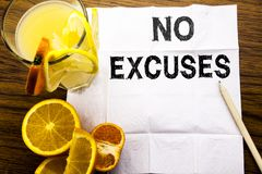 Conceptual text caption showing No Excuses. Concept for Stop Ban for Excuse written on tissue paper on the wooden background with. Conceptual text caption Royalty Free Stock Images