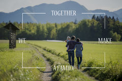Conceptual text over young family on a country road Royalty Free Stock Images