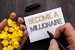 Conceptual text showing Become A Millionaire. Business photo showcasing Ambition To Become Wealthy Earn Fortune Fortunate written. Notebook Book Man Writing Royalty Free Stock Photo