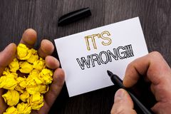 Conceptual text showing It Is Wrong. Business photo showcasing Correct Right Decision To Make Or Mistake Advice written on Noteboo. Conceptual text showing It Is Royalty Free Stock Photography