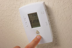 Conceptual Thermostat Saving Money Stock Photos