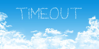 Conceptual time out illustration with clouds on blue sky. Conceptual business illustration with timeout cloud fonts on blue sky background, with cumulus clouds Royalty Free Stock Photos