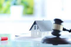 Conceptual White Little House on Top of Documents Stock Photos