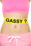 Conceptual Woman Stomach with Gassy Text on Tape Royalty Free Stock Photo