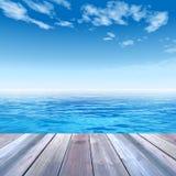 Conceptual wood deck over sea and sky Stock Photos