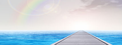 Conceptual wood deck pier on sea water banner stock photography