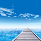 Conceptual wood deck pier on sea water Royalty Free Stock Photos