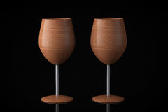 Conceptual Wooden Wine Glasses. On a black background stock photos