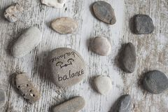 Conceptual words on stones. Round stones with wellness concepts stock photos