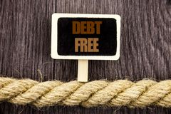 Conceptual writing text showing Debt Free. Business photo showcasing Credit Money Financial Sign Freedom From Loan Mortage written. Blackboard Hanging rope Stock Image