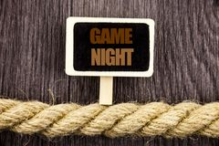 Conceptual writing text showing Game Night. Business photo showcasing Entertainment Fun Play Time Event For Gaming written Blackbo. Ard Hanging rope wooden stock photos