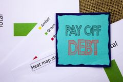 Conceptual writing text showing Pay Off Debt. Concept meaning Reminder To Paying Owed Financial Credit Loan Bills written on Stick. Conceptual writing text Royalty Free Stock Photo