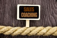 Conceptual writing text showing Sales Coaching. Business photo showcasing Business Goal Achievement Mentoring written Blackboard H. Anging rope wooden background Stock Photo