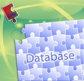 Conceptually. the database is updated. Conceptual image of database replenishment. Picture puzzles with the words Database and a puzzle piece with the Royalty Free Stock Images