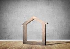 Conceptuele achtergrond van concreet huisteken in ruimte met houten vloer Royalty-vrije Stock Afbeelding