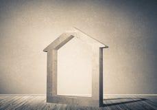 Conceptuele achtergrond van concreet huisteken in ruimte met w Royalty-vrije Stock Foto