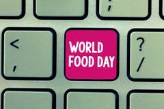 Conceptuele hand die tonend de Dag van het Wereldvoedsel schrijven De dag van de bedrijfsfoto demonstratiewereld van actie gewijd stock foto