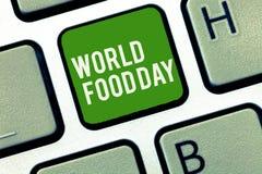 Conceptuele hand die tonend de Dag van het Wereldvoedsel schrijven De dag van de bedrijfsfoto demonstratiewereld van actie gewijd stock fotografie
