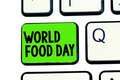 Conceptuele hand die tonend de Dag van het Wereldvoedsel schrijven De Werelddag van de bedrijfsfototekst van actie gewijd aan glo royalty-vrije stock fotografie