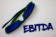 Conceptuele hand die tonend Ebitda schrijven De Inkomens van de bedrijfsfototekst vóór de Afkorting van de de Waardeverminderings royalty-vrije stock fotografie