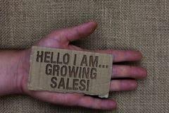 Conceptuele hand die tonend Hello ben ik schrijven Groeiende Verkoop Bedrijfsfototekst die tot meer geld maken het Verkopen grote stock afbeelding