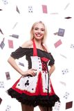 Conceptul image of gorgeous blonde entertainer girl in casino ty. Pe outfit with playing cards falling all over the frame. Chance and risk. Gambling and winning Stock Image