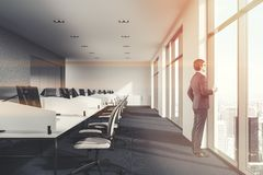 Concerete and white loft office, businessman Royalty Free Stock Image
