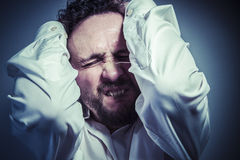 Concern for the future, man with intense expression, white shirt Stock Photos