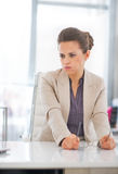 Concerned business woman with eyeglasses Stock Images