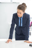 Concerned business woman near flipchart Stock Photo