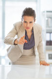 Concerned business woman pointing in camera Royalty Free Stock Images