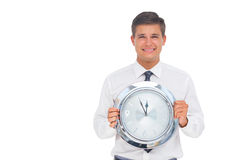 Concerned businessman holding clock Royalty Free Stock Photos