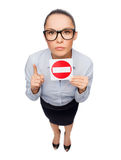 Concerned businesswoman showing stop sign Stock Photo