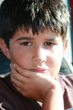 Concerned Child. Thoughtful young boy with hand on chin Royalty Free Stock Photos