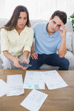 Concerned couple doing their accounts Stock Images