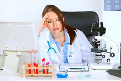 Concerned doctor woman sitting at office table Royalty Free Stock Photography