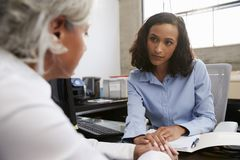 Concerned female analyst counselling senior patient royalty free stock photography