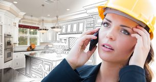 Concerned Female Contractor Using Smart Phone Over Kitchen Drawing Gradating to Photo. Behind Her royalty free stock photo