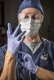 Concerned Female Doctor or Nurse Putting on Protective Facial We Stock Images