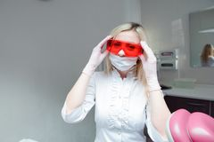 Concerned Female Doctor or Nurse Wearing Protective Facial Wear. stock photo