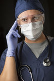 Concerned Female Doctor or Nurse Wearing Protective Facial Wear Stock Photography