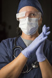 Concerned Female Doctor or Nurse Wearing Protective Facial Wear Stock Photos