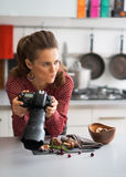 Concerned female food photographer checking photos Royalty Free Stock Photo