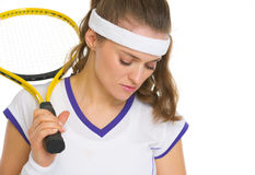 Concerned female tennis player with racket Royalty Free Stock Images