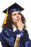 Concerned about the future. Beautiful young graduate thinking over her life and future Royalty Free Stock Image