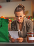 Concerned housewife looking on checks after christmas shopping Royalty Free Stock Images